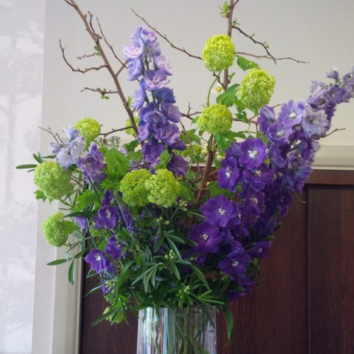 Purple contract flower display by Blue Lavender London florist