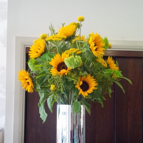 Bright yellow contract flower display by Blue Lavender London florist