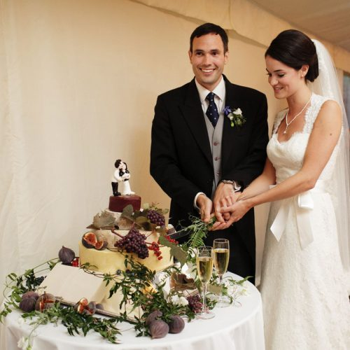 Wedding cake decorated with flowers by Blue Lavender London florist