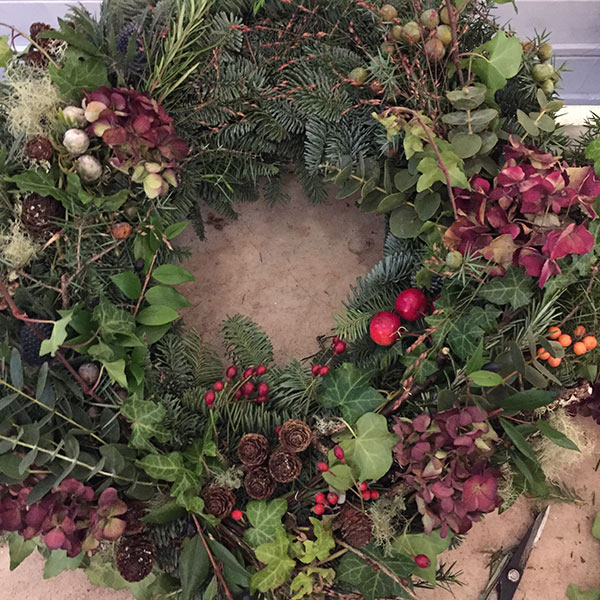 Wreath with hydrangea and rosehips by Blue Lavender Florist, London