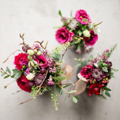 Red ranunculus table arrangements by Blue Lavender London Florist