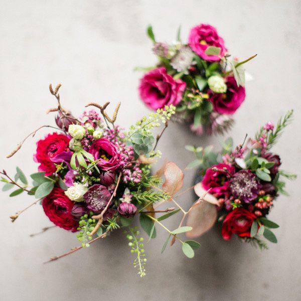 Red ranunculus table arrangements by Blue Lavender London Florist