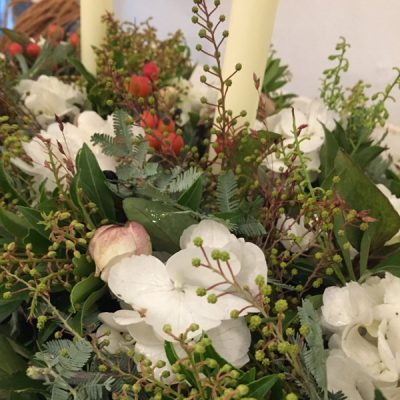 Table arrangement with candles by Blue Lavender Florist London
