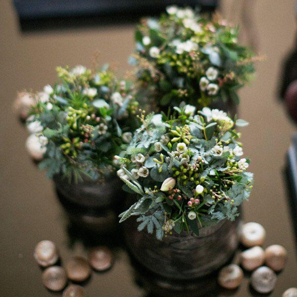 White seasonal table arrangements by Blue Lavender Florist London