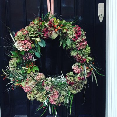 Wreath with hydrangea, grass, moss and eucalyptus pods by Blue Lavender Florist London