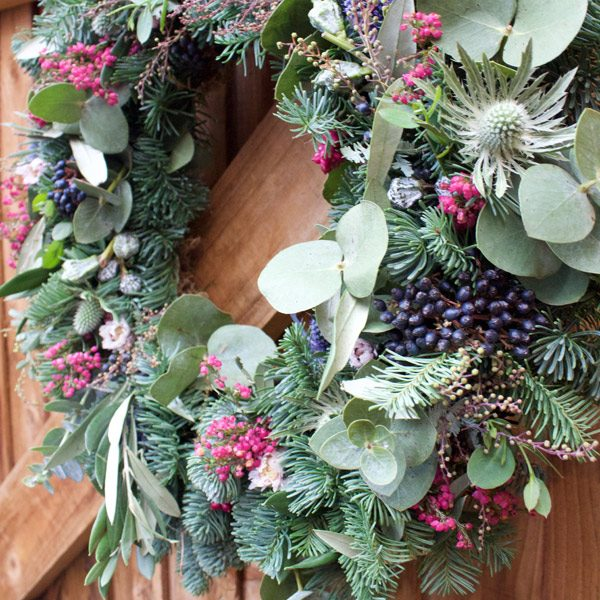Wreath with spruce, eucalyptus, thistles, erica and memos by Blue Lavender Florist London