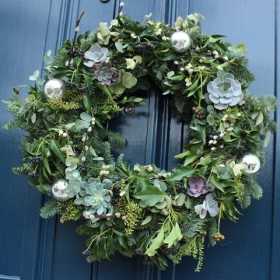 Wreath with succulents, pussy willow, ivy berries, eucalyptus, spruce by Blue Lavender Florist London