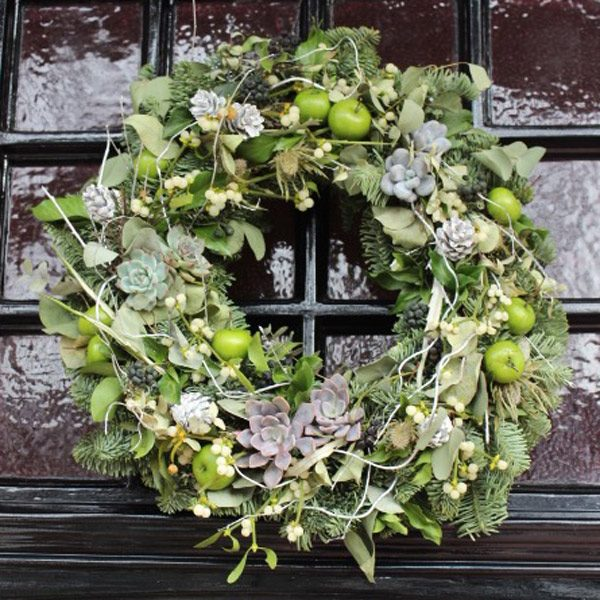 Wreath with succulents, spruce, apples, pine cones and ivy by Blue Lavender Florist London