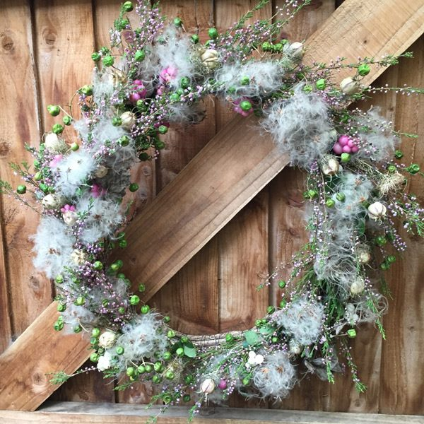 Wreath with old man bears, vine twigs, heather and dry flowers by Blue Lavender Florist London