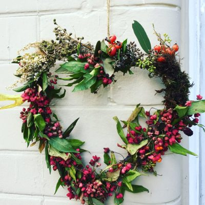 Heart wreath with rosehips, heather and dry flowers by Blue Lavender Florist London