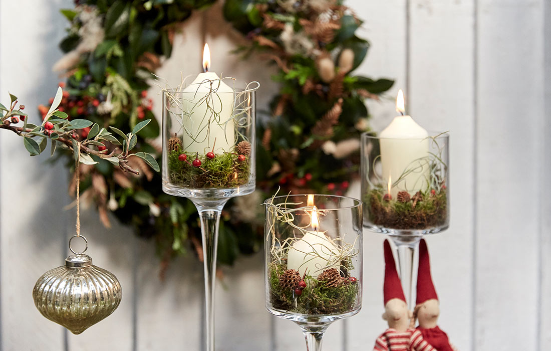 Christmas candle display with floral elements by Blue Lavender florists