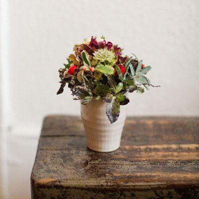 Small ceram,ic pot with floral arrangement